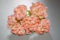 Coral dahlia corsage