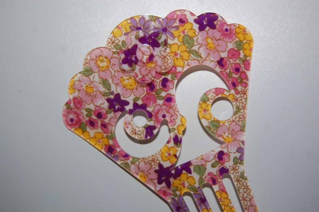 Peina floral amarillo, morado y rosa