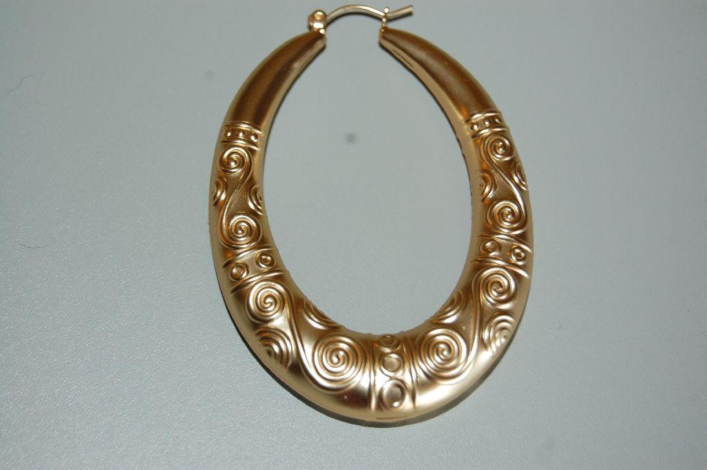 Oval golden rings